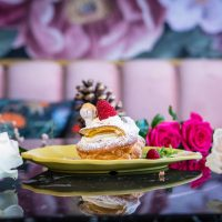 """""""The Swan,"""" an elegant and indulgent Belgian pastry and dessert, served with cream and red berries."""